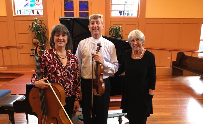 The Bridge players standing together with their instruments